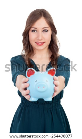 Smiling young girl with a blue money-box isolated on a white background - stock photo