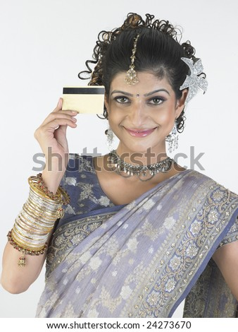 Smiling young girl with credit card - stock photo