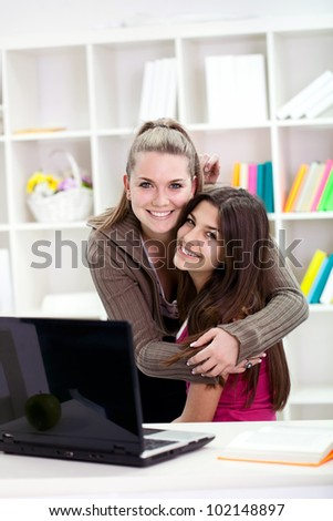 smiling young girls hugging who love each other - stock photo