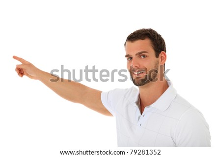 Smiling young guy pointing with finger. All on white background. - stock photo