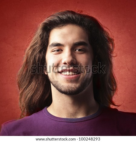 Smiling young handsome man - stock photo