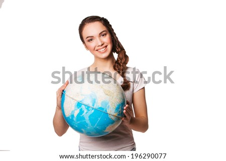 smiling young lady holding a world globe - stock photo