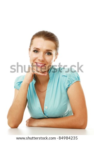 Smiling young lady with chin resting on hand isolated on white background - stock photo