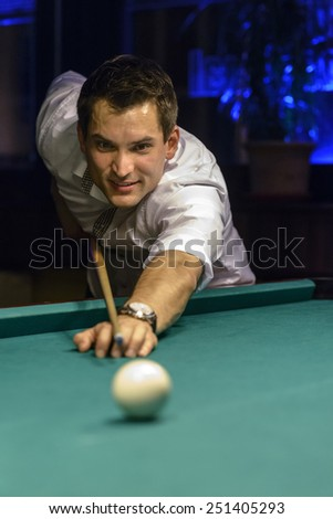 smiling young male billiard player - stock photo
