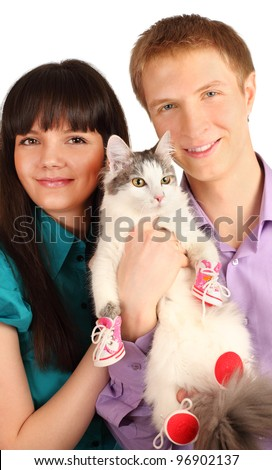 Smiling young man and woman hold cat wearing in red boots isolated on white background - stock photo