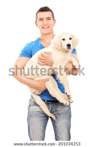 Smiling young man holding a dog isolated on white background - stock photo