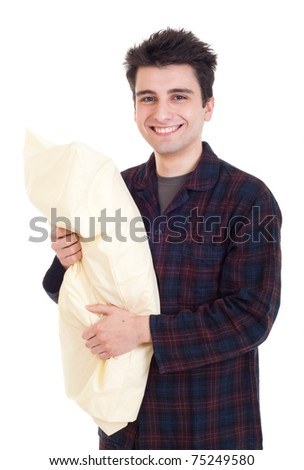 smiling young man in pajamas holding pillow isolated on white background - stock photo