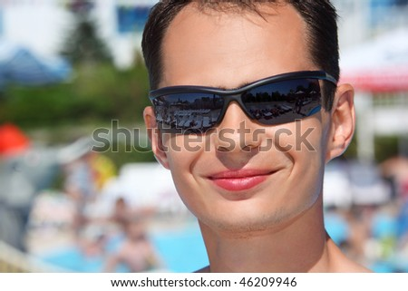 smiling young man in sunglasses in aquapark - stock photo