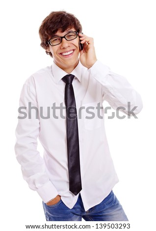 Smiling young man in white shirt, blue jeans and black glasses talking by mobile phone. Isolated on white background, mask included - stock photo