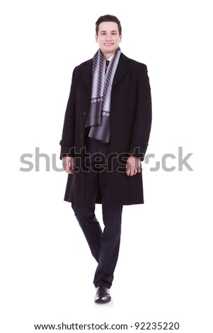 smiling young man looking at the camera on white background - stock photo