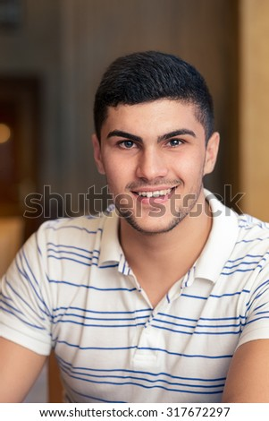 Smiling Young Man Portrait - Handsome man relaxing in a bar - stock photo