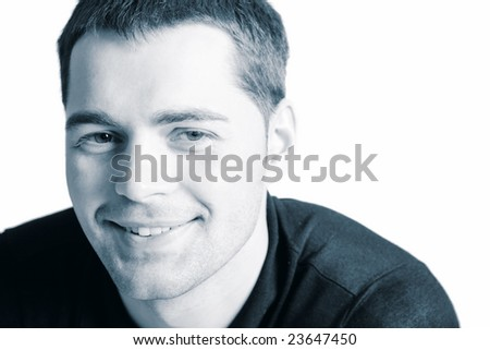 Smiling Young man's face closeup isolated - stock photo