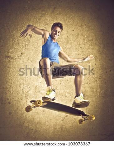 Smiling young man skateboarding - stock photo