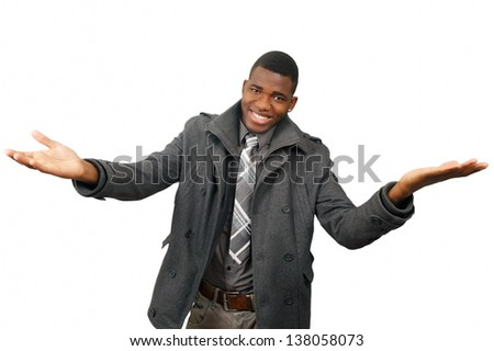 Smiling young man with arms outstretched gesture - stock photo