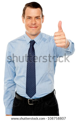 Smiling young man with thumbs up gesture, business concept - stock photo