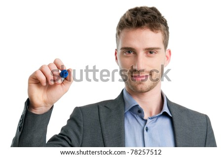 Smiling young man writing with marker isolated on white background - stock photo
