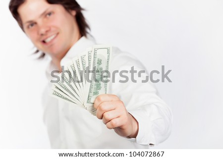 Smiling young men holding dollars in hands - stock photo