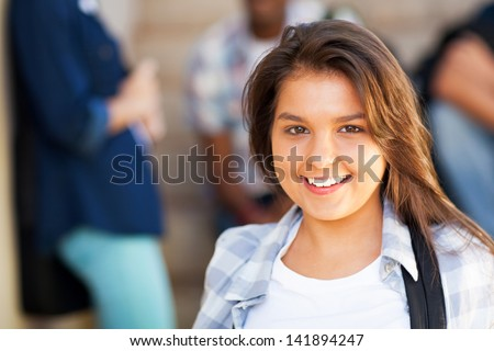 smiling young middle school girl with friends on background - stock photo
