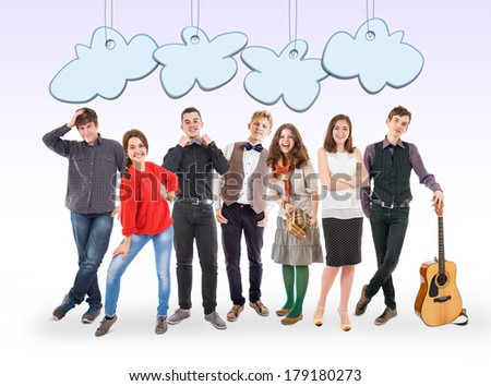 Smiling young people group with funny cartoon clouds - stock photo