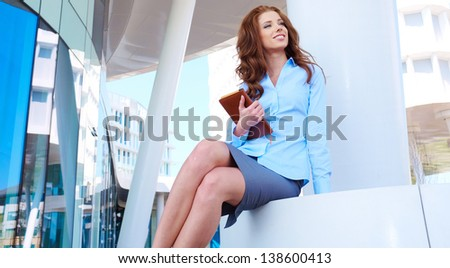 Smiling Young Pretty Female Student Standing Outside - stock photo