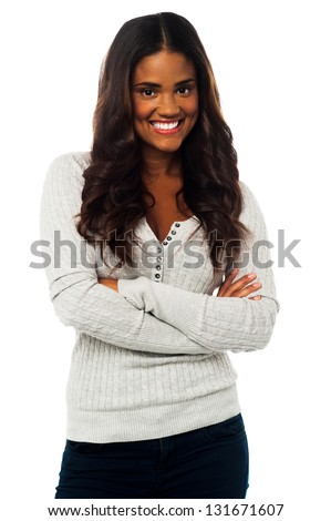 Smiling young pretty woman posing with her arms crossed, isolated over white. - stock photo