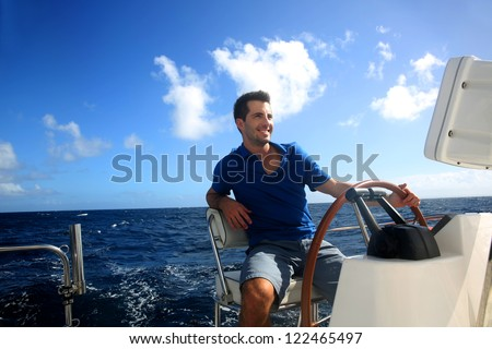 Smiling young sailor navigating in Caribbean sea - stock photo