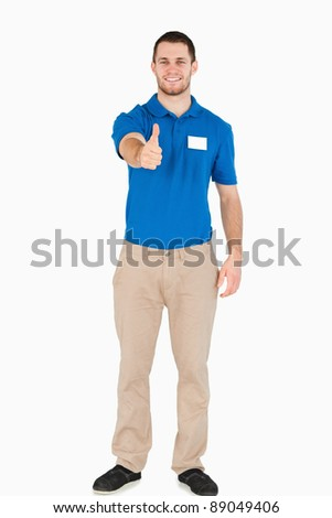 Smiling young salesman giving his approval against a white background - stock photo