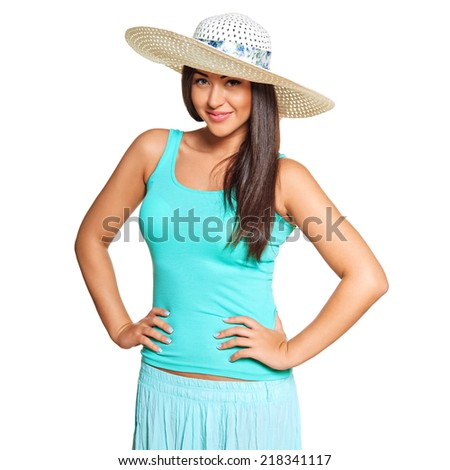 Smiling young sun-tanned woman in  tshirt and straw hat   isolated on white background - stock photo