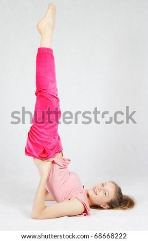 Smiling young  teenage girl doing fitness exercises - stock photo
