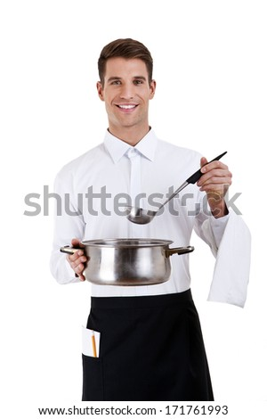 smiling young waiter with metal pan pot in his hand isolated - stock photo