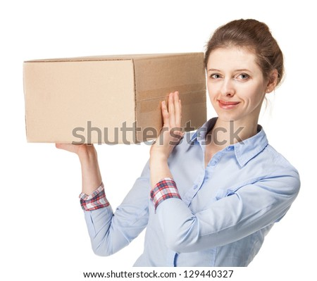 Smiling young woman carrying a big box; isolated on white background - stock photo