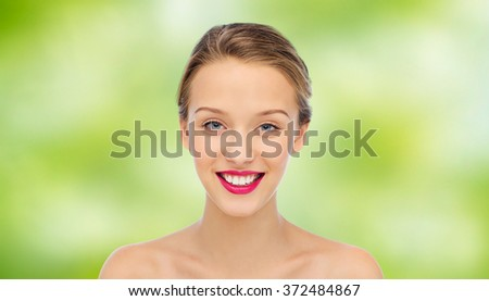 smiling young woman face and shoulders - stock photo