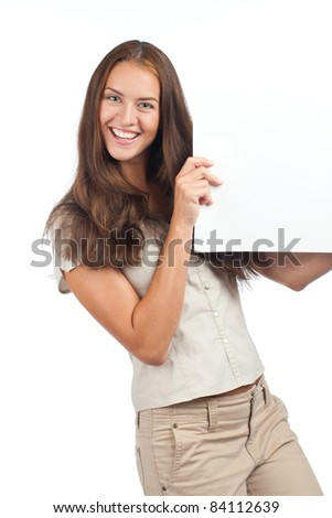 Smiling young woman holding a blank billboard, isolated on white background - stock photo