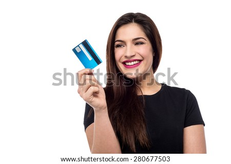 Smiling young woman holding credit card - stock photo