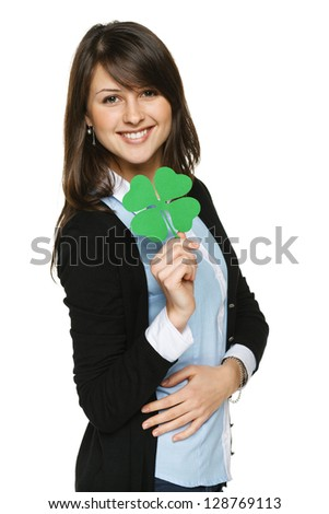 Smiling young woman holding shamrock leaf, isolated on white background - stock photo