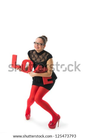 smiling young woman holds a large 3d letters love.celebrating Valentine\s Day - stock photo