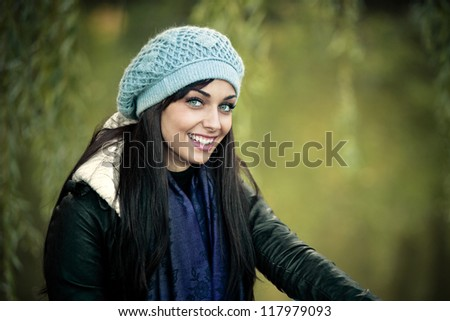 smiling young woman in winter clothes outdoor portrait - stock photo