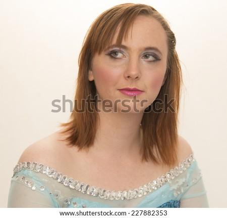 Smiling young woman portrait studio shot - stock photo