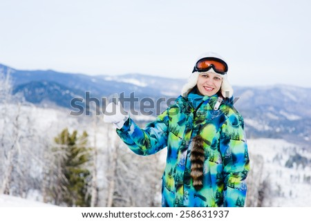 smiling young woman showing thumbs up - stock photo