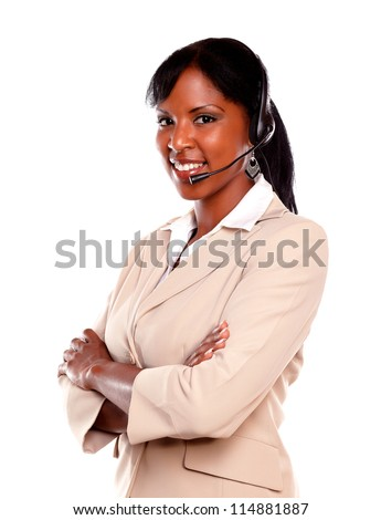 Smiling young woman wearing a headset against white background - stock photo