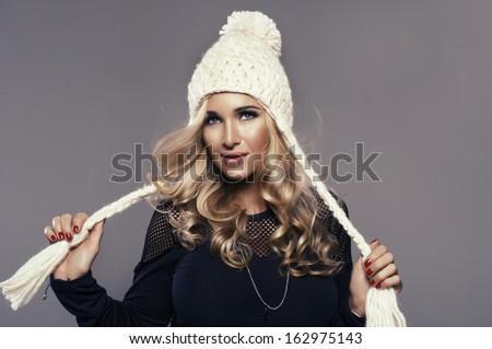 smiling young woman wearing winter cap  - stock photo