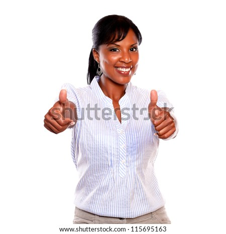 Smiling young woman with a winning attitude against white background - stock photo