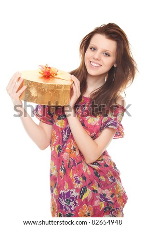 smiling young woman with gift gold box as heart isolated on white background - stock photo