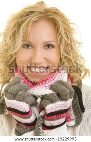 Smiling young woman with gloves and a scarf - stock photo