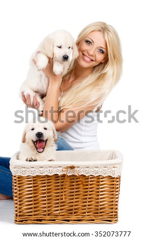 smiling young woman with pet puppy, studio shot. Close up of woman in white sweater with puppy of labrador. Retriever. Love. Puppies. Dogs. Healthcare. - stock photo