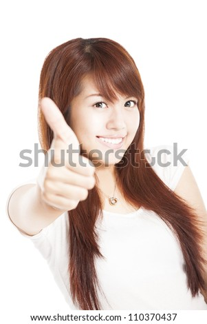 smiling young woman with thumbs up - stock photo