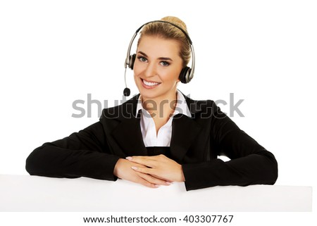 Smille call center woman holding empty banner. - stock photo