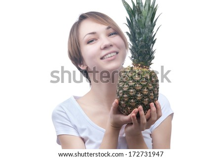 smilling girl with pinaple isolated on white - stock photo