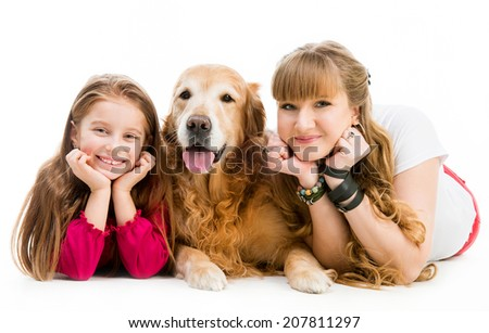 smilling woman and little girl with a red retriever - stock photo