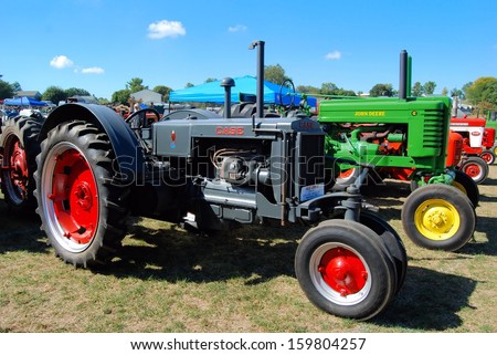 SMITHSBURG, MDÂ?Â? SEPTEMBER 29:  Tractors at the Steam Engine and Craft Show on September 29, 2013 in Smithsburg, MD.  The event attracts 20,000 people and features farm tractors and demonstrations.  - stock photo